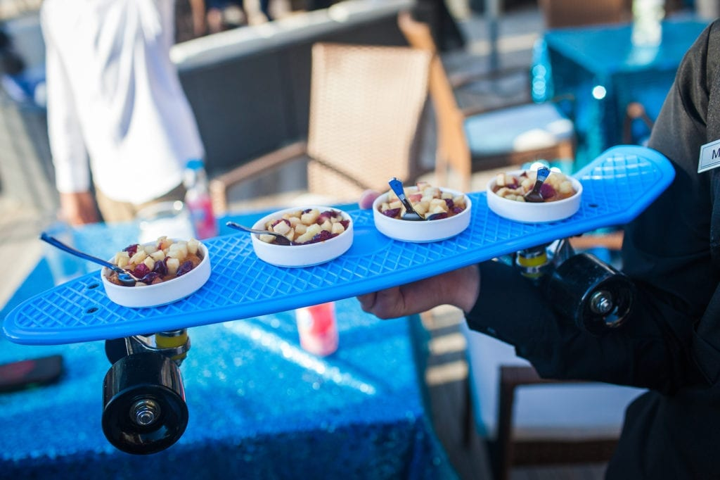 One of the many appetizers offered by the Crescent Beach Club in little bowls being served at cocktail hour on a mini skateboard tray