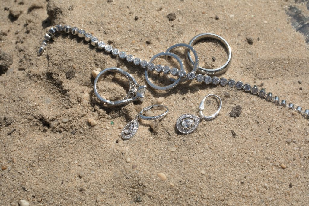 wedding jewelry on beach